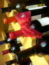 Free Wine Bottles With Red Ribbon Stacked On Wooden Rac Royalty Free Stock Photos - 22797508