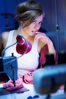 Free Seductive Blond Sewing In Her Workshop Stock Photography - 22790672