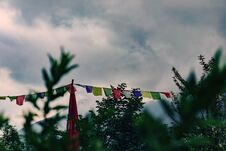 Colored Tibetan Flags. Vegetation On The Foreground. Clouds And Mountains On The Background. Concept Of Tibetan Culture, Buddhism Stock Images