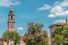 Vigevano, Italy: The Clock Tower And The Castle. Colored Vegetation On The Foreground. Copy Space Stock Photos