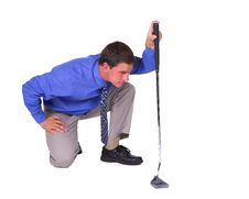 Free Man Aiming Over Putter Royalty Free Stock Photo - 2282125