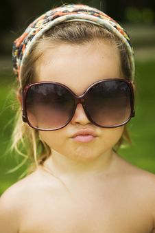 Free The Little Girl Wears A Large Adult Sunglasses Stock Photos - 22802913