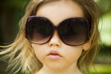 Free Little Girl Wears A Large Adult Sunglasses Royalty Free Stock Photo - 22802925