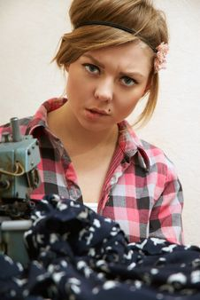 Free Woman Seamstress Posing Near Sewing Machine Royalty Free Stock Photography - 22808487