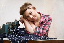 Free Woman Seamstress Posing Near Sewing Machine Royalty Free Stock Photography - 22808687