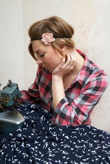 Woman Seamstress Posing Near Sewing Machine Stock Photos