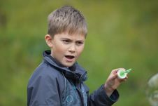Free The Boy Starts Up Soap Bubbles Stock Photography - 22828052