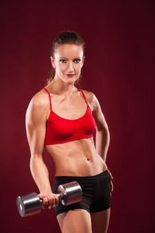 Young Fit Woman Lifting Dumbell Stock Photography