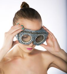 Free Wellness - Female In Metallic Silver Binoculars Stock Image - 22847451