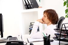 Free Young Businessman Thinking In Office Royalty Free Stock Photography - 22856747