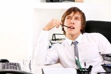 Free Young Businessman Thinking In Office Royalty Free Stock Photo - 22856755
