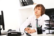 Free Young Businessman Thinking In Office Royalty Free Stock Images - 22856759