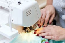 Free Female Hands Working On A Sewing Machine Royalty Free Stock Photos - 22867828