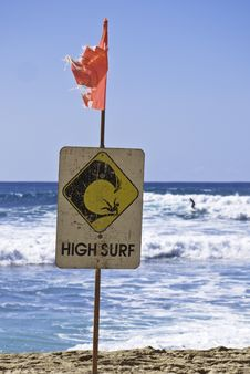 Free High Surf Danger Sign With Surfer In Background Stock Photo - 22871650