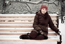Young Woman In Winter Park On A Bench Stock Images