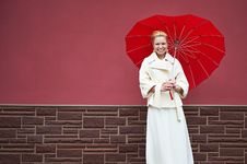 Free Woman In White Coat With Red Umbrella Royalty Free Stock Image - 22887746