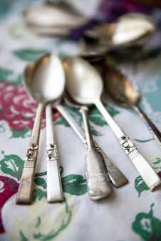 Vintage Silver Spoons On An Antique Tablecloth Royalty Free Stock Image