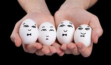Free Hand Holding Cute Eggs With Funny Face Smileys Stock Photos - 22891873