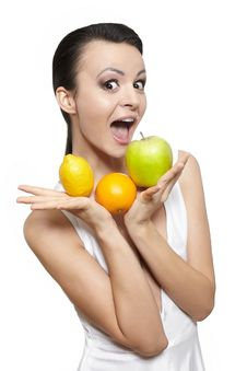 Free Happy Girl With Fruits Lemon And Green Apple Royalty Free Stock Photography - 22898287