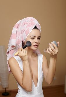 Woman In Towel On The Head Applying Makeup Royalty Free Stock Photography