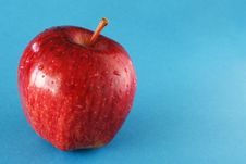 Free Red Apple On Blue Royalty Free Stock Photo - 2293285