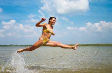 Girl Jumping Above The Lake Royalty Free Stock Photos