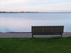 Free Single Wooden Bench In Front Of The Sea Stock Photos - 22909303