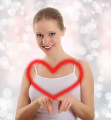 Free Beautiful Young Woman Draws A Big Red Heart Stock Photos - 22912793