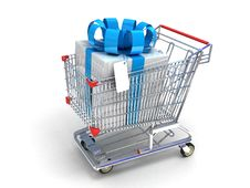 Shopping Trolley And Gifts Royalty Free Stock Photo