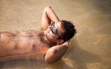 Free Indian Man Swimming At Ocean Beach Royalty Free Stock Photo - 22917205