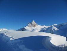 Snow Covered Alpine Scene Stock Photo