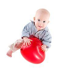 Baby Boy With Heart Shaped Balloon Stock Photos