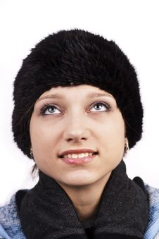 Free Young Smiling Woman In Cap Looking Up Stock Image - 22931141