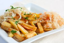 Sliced potatoes With Onions And Sauerkraut Stock Photo