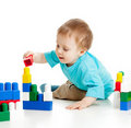 Free Cheerful Child With Construction Set Over White Royalty Free Stock Photo - 22958885