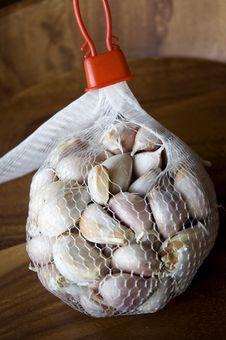 Garlic In Net Bag Stock Photo