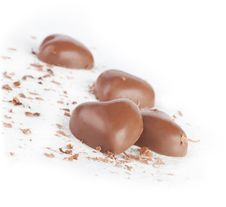 Free Chocolate Hearts And Chips On White Background. Royalty Free Stock Photo - 22976955