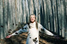 Free Beautiful Blonde Girl With Falling Leaves Royalty Free Stock Photography - 22979547