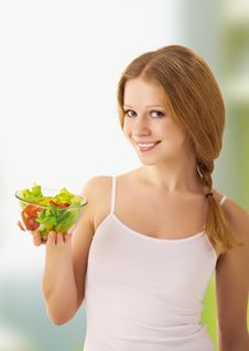 Beautiful Young Woman With Vegetarian Salad Stock Photo