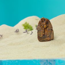 Free Egyptian Bust In Miniature Sandy Landscape Stock Image - 22986901