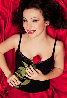 Woman And Red Rose Stock Image