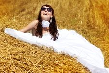 Free Bride Relaxing In Hay Stack Stock Photo - 22990370