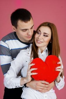 Young Couple With Red Heart Royalty Free Stock Image