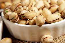 Free Pistachios In A White Saucer Stock Image - 22996571