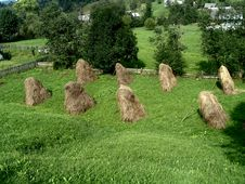 Free Mountain Pasture With Small Hay Stacks Stock Photography - 231232