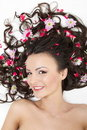 Free Smiling Girl Lying With Red Flowers In Her Hair Stock Photo - 23006230
