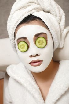 Free Chinese Woman With Cucumbers And Mask Stock Photo - 23006040