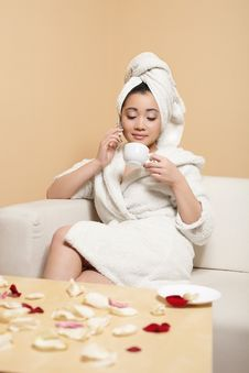 Chinese In White Bathrobe With Towel On Head Royalty Free Stock Photography