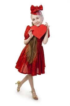 Small Playful Girl With Heart In Her Hands Royalty Free Stock Images