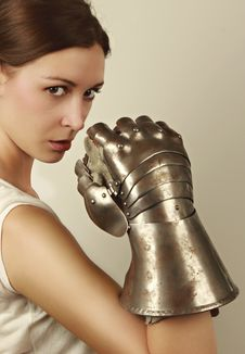 Young Woman With Steel Glove Royalty Free Stock Photo